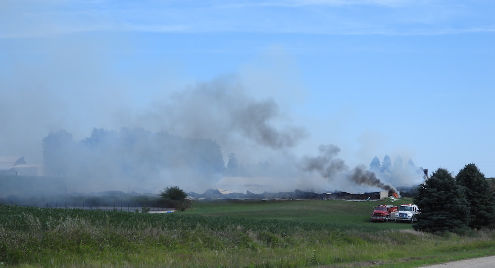 Multiple departments from three counties fight hog confinement fire near Pierson Iowa